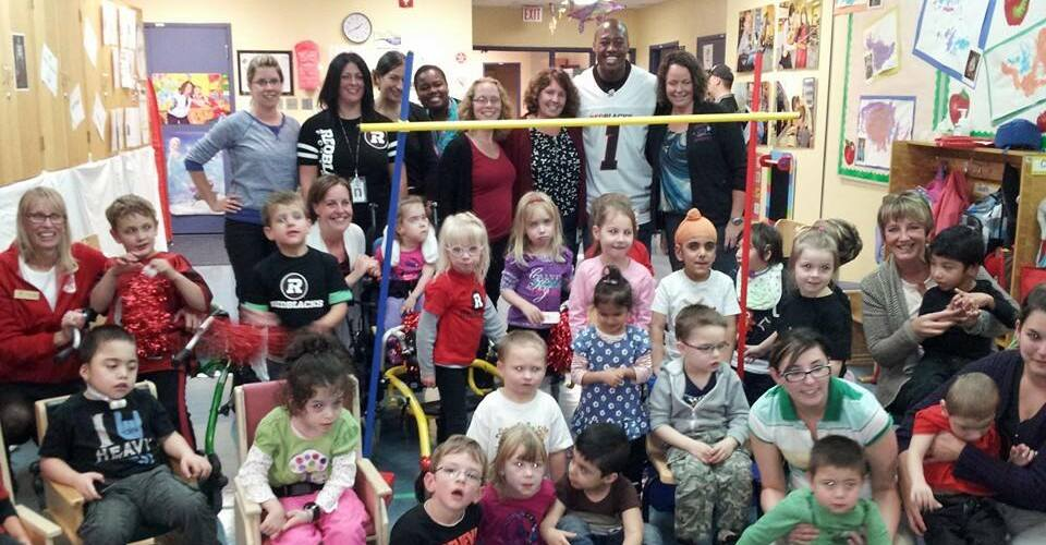 Photo of students and Henry Burris during an OCTC visit