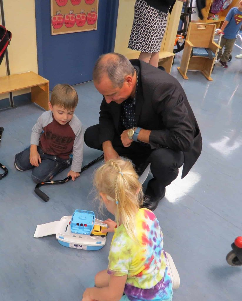 A parent playing with the kids in OCTC
